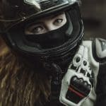 woman with motorcycle face mask and helmet