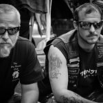two bikers sitting in motorcycle glasses